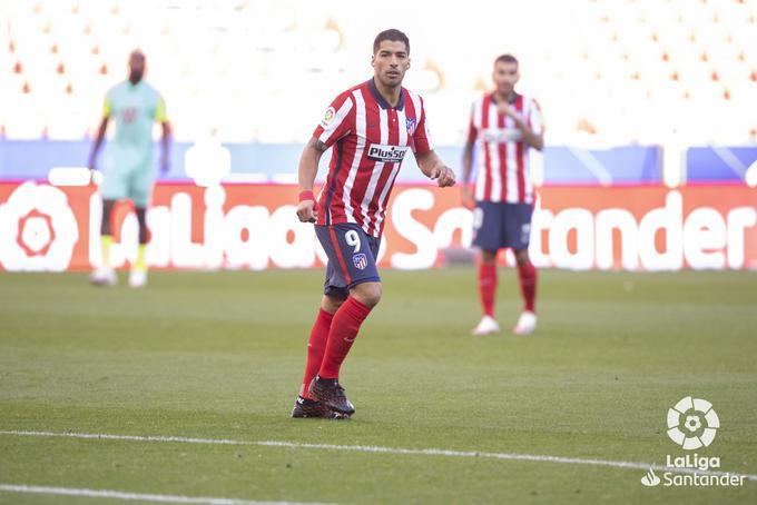 Suárez durante un partido con el Atleti